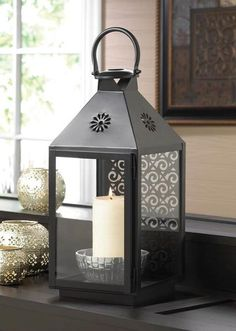 Indoors Or Outside On The Patio This Large Iron Candle Lantern Will Give Your Living