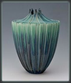 "Newman Ceramic Works - Seedpod Vase Shown here is the Seedpod Vase from Newman Ceramic Works. It's gorgeous Opal Creek glaze makes this piece really stand out. Measures 7"" H x 10.25"" W"