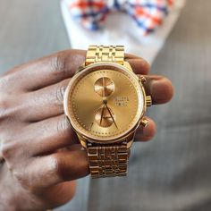 The Gold Worley Chronograph M from Talley & Twine Watch Company. It features a metallic 46mm face and a 22mm band width.