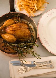 Roasted Chicken for 2 with Pomme Frites, by Alain Ducasse at Benoit NYC.  Most amazing, simple dish I've had yet.  Perfection.