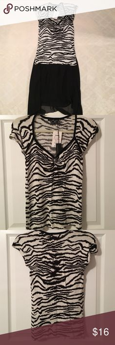 NWT Zebra print top Zebra print top. Open circle at the top. Willi Smith bought from TJ Maxx size small. 83% viscose 17% spandex, very soft. New with tags. Willi Smith Tops Tees - Short Sleeve