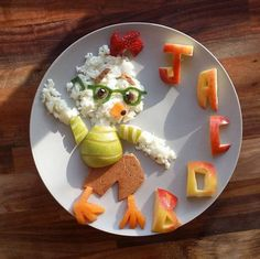 jacobs_food_diary_Mum makes healthy food fun for toddler by turning meals into cartoon characters - Chicken Little - egg whites with toasted cheese and wholemeal wrap, pear, persimmon, strawberries, cucumber and apple letters (Photo: Instagram/jacobs_food_diaries)