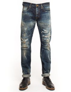 Turning out all the technique tricks for the PRPS Noir Anteater Jean, made from 13.5 oz denim, featuring heavy rip and repair, bleach splatter and light fading. Demon fit is mid rise and slim.