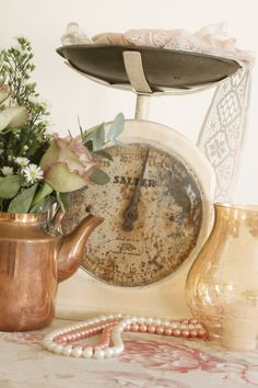 Use one for decor just holding lace or string or place a dainty table number on top