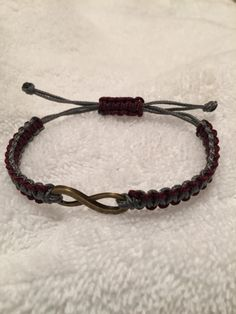 Women's silver gray and maroon handmade adjustable micro paracord bracelet with bronze tone infinity charm. by StillhouseCreations on Etsy