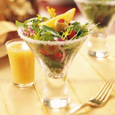 Spectacular Dirty Martini Salad Recipe...use this recipe or your favorite.  I just love the presentation!  Using the shot glass for the salad dressing along side the martini glass is just so cute...