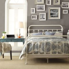 This metal bed frame creates a unique and modern style that is sophisticated yet simple and can be accented to compliment any decor. The frame features spindles in the headboard and footboard and elegantly crafted castings at each joint.