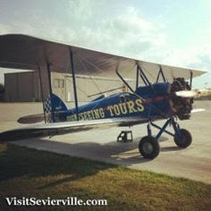 Take the plunge and hop in the #Bi-Plane at the Sky High Air Tours in #Sevierville - Slice through the #SmokyMountain air with a loved one.
