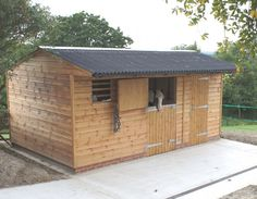 L Shape stable block with stable, corner box, tack room and hay barn with wide barn doors. Black Onduline roof with galvanised ridge. Horse Shed, Horse Stalls, Small Horse Barns, Horse Tack Rooms, Hay Barn, Dream Barn, Dream Stables, Horse Property, Shed Plans