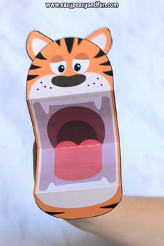 Ready for some fun time? Grab this tiger puppet printable template and let the fun begin. This tiger craft for kids is a quick mess free, no prep activity to do with your kids. It's also a great prop for story time (preschoolers and kids in kindergarten absolutely love them). Mix and match them with our other printable puppets for even more fun. #crafts #craftsforkids