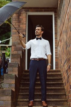 Bow tie, striped slacks, white button shirt