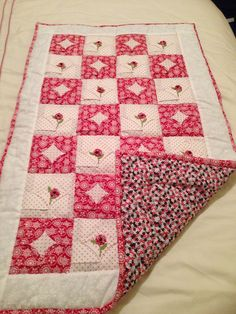 Hand quilted lap quilt with cathedral windows and flower applique using yoyos
