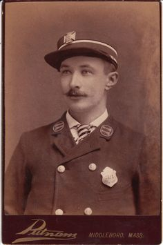 This Cabinet Card is an image of a fireman wearing his dress uniform. Note the badges; one of which indicates that he was a member of the Middleboro Fire Department and badge number 33. The photograph was taken at the Putnam Studio in Middleboro, Massachusetts.