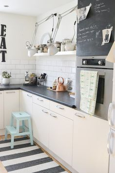 Kitchen Inspiration. Love the blue stool, and the eat, plus the chalk board.