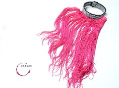 A personal favorite from my Etsy shop https://www.etsy.com/listing/585752966/magenta-silk-fringe-necklace-tassel