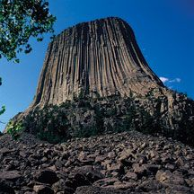 Devils Tower National Monument  A unique and striking geologic wonder steeped in Indian legend is a modern day national park and climbers' challenge. Devils Tower located in the Black Hills of northeast Wyoming.  The tower is a solitary, stump-shaped granite formation that looms 1,267 feet above the tree-lined Belle Fourche River Valley, like a skyscraper in the country. Once hidden below the earth's surface, erosion has stripped away the softer rock layers revealing the Tower.