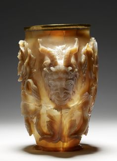 Rubens Vase  (4th century CE) -- Carved from a single piece of chalcedonic agate, the vase was created for a Byzantine emperor. Delicate vine stocks, satyr-head handles and the grinning Pan in relief enhance the waxy luster, the translucency and the warm honeyed hues of the agate