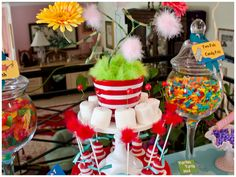 """I wasn't able to do a backdrop, so I made ""Truffula Trees"" out of some tissue poms and curly decor sticks from IKEA… I loved them! My favorite part of the table was the smallest part… in the flower centerpiece I made some ""Horton clovers"" and on one of those clovers was the tiny speck (sugar pearl). All it took was one person to notice it and the news quickly spread….. ahhhh, details make me smile!"""