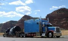 """HOME ON THE ROAD"" -- That's how Gregg Blair describes the 1999 Peterbilt he last owned. The big blue truck is a '99 Pete. 600 h.p. C16 cat with auto shift 18 speed. 355 rears. Full length double frame. 500 gallons fuel. The sleeper is a 200"" ICT on air ride bunk mate.  The back 50"" is a garage with an electric motorcycle lift.   Keeps the bike clean like it is in the back seat of your car. I put about 1.75 million miles on that truck. Inside the sleeper,  kitchen, shower & toilet…"