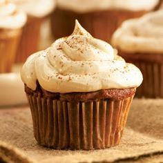 Shredded apple replaces some of the oil in these Apple Cupcakes with Cinnamon-Marshmallow Frosting and keeps the cake moist! Pipe the frosting for an especially festive look for your fall table.