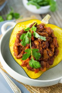 This Chili Stuffed Acorn Squash is a perfect one dish meal! #winter #vegan #glutenfree #comfortfood