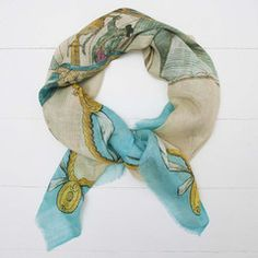 Manipuri Balloon Scarf. Hot air balloon print scarf in cream featuring turquoise outer border, soft fray edge detail. Beautifully detailed print, perhaps wear with a touch of pink to compliment the man in the balloon's pretty pink jacket.£85