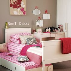 Cute idea for little girls bedroom. I like the polka dots and the throws on the bed. The bunny on the head board is cute.