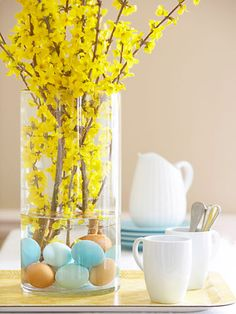 Anchor brilliant forsythia — and give a tongue-in-cheek nod to Easter — with subtly hued hard-cooked eggs. #crafts