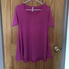 LuLaRoe Perfect Tee Purplish Pink Perfect Tee from LuLuRoe. Too small in the arms for me. Worn once, washed once to LLR instructions. LuLaRoe Tops