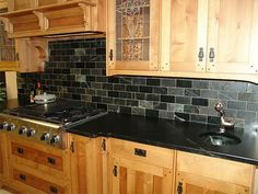Black kitchen backsplash stainless steel kitchen cabinets with black subway tile white kitchen cabinets black countertops . Black Kitchens, White Kitchen Backsplash, Glass Tile Backsplash Kitchen, Kitchen Decor, Slate Backsplash, Sleek Kitchen, Kitchen Design Modern White, Kitchen Tiles, Black Countertops