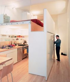 In this collection of smart designs for lofts, we check out the very clever, storage-minded kitchen shown here.