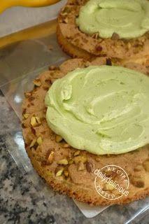 Crème mousseline consists of:  1. Crème au beurre (custard, it. meringue and butter), 2. Crème pâtissière (milk, flour, yolks) and 3. pistachio paste.  Here, used on a dacquoise for a Fraisier