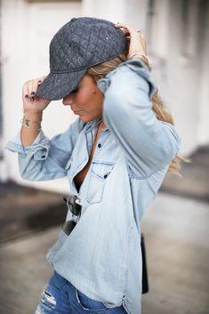 chambray shirt and a baseball cap