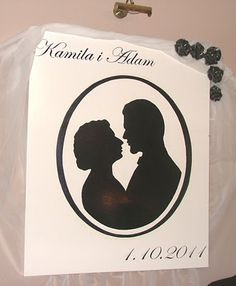 wedding decoration- I painted our silhouettes on huge canvas, then guests writed wishes with silver pens on it, around oval. Great reminder.