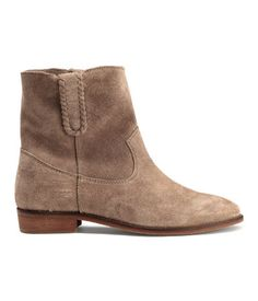 Beige. PREMIUM QUALITY. Suede ankle boots with decorative seams and a loop at sides. Cotton twill insoles and rubber soles. Heel height 1 in.