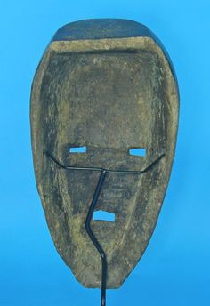 Since African or tribal masks are not made from a mold they all need a customized way to hold them. Armature mask displays offer a way to customize the display to hold your mask by bending the wire yourself to make it fit. They are available at: http://www.artdisplay.com/mask-stand.html #africanmask #africanart #tribalmask #maskdisplay