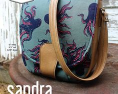 Sandra is a inspired saddle bag sewing pattern featuring an exterior slip… Bag Patterns To Sew, Pdf Sewing Patterns, Purse Pattern Sewing, Sandro, Barrel Bag, Simple Bags, Love Sewing, Couture, Bag Making