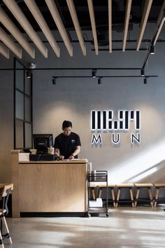 Register area. MUN Korean Restaurant, Melbourne. Design and Build by Salt Design and Construction. Vic Ash timber louvred ceiling feature by Timber Revival.