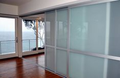 Laminated glass room dividers let you open up or divide space while still allowing light to flow through.