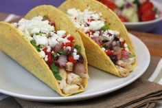 Greek Chicken Tacos | Reluctant Entertainer.com - Hungry Girl recipe - These are SO tasty! The Feta, red onion, and a homemade greek vinegarette ....such a great mix!