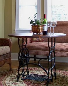 The Comforts of Home: tables made from sewing machine base and a round of wood from Lowe's. Now to find a base like it.