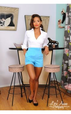 The Laura Byrnes Shorts feature a high Empire waistline with a subtle curve that flatters every figure and elastic ruched panels on the back to allow for comfort and flexibility in movement. The shorts feature patch pockets, front seaming, and cuffs for a polished, vintage-style look. - See more at: http://www.pinupgirlclothing.com/laura-byrnes-shorts-blue.html#sthash.ZRMpVFre.dpuf
