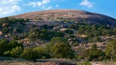 Enchanted Rock State Park, Fredericksburg, Texas -- Legend states Tonkawa Indians named this popular 425-foot pink granite batholith, believing a Spanish conquistador cast a spell on it, making magical ghost fires glow at the top.