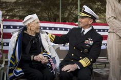 Chief of Naval Operations Admiral Jonathan Greenert shares a moment with World War II veteran Con Crabb during the Chattanooga Armed Forces Day parade.