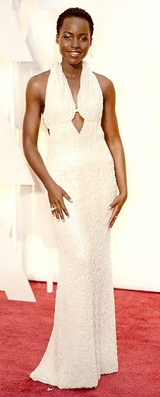 The Twelve Years a Slave actress made her Oscars red carpet return in a jaw-dropping custom Calvin Klein Collection gown that was dripping in pearls.