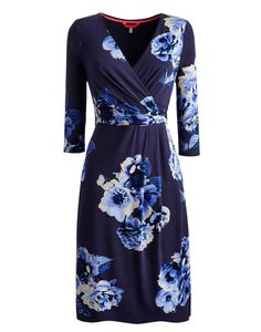 Joules Women's On The Knee Dress, French Navy Butterfly.                     The bold two tone photographic floral print makes this flattering fixed wrap dress a true stand-out piece.  Crafted from exceptional quality soft jersey, with knife pleats to the front, three quarter sleeves and cut to sit on the knee it's a useful item to see you through smart days at work to evenings out.
