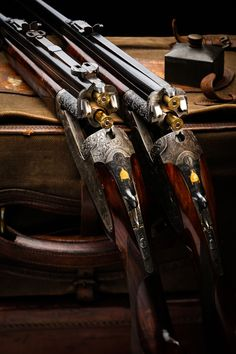 Things of art! A pair of Over/Under heavy hunting, magnum caliber rifles. Weapons Guns, Guns And Ammo, Custom Guns, Fire Powers, Hunting Rifles, Cool Guns, Old West, Firearms, Shotguns