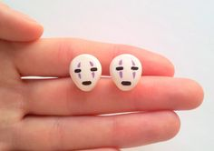 Post earrings featuring No Face from Studio Ghibli's 'Spirited Away', a perfect gift for Ghibli lovers. Handmade these with using polymer clay and acrylic paint for the details. The earring studs are silver plated.