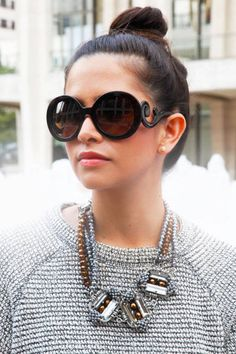 Showgoer; Prada sunglasses, necklaces of her own design