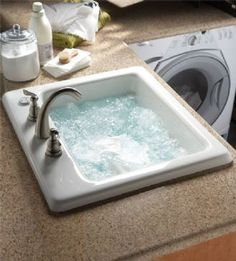 a sink in the laundry room with jets for delicates.